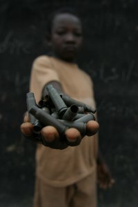 A demobilized child soldier in a rebel camp in the Central African Republic. Photo by Pierre Holtz of UNICEF